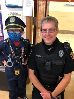 Local police man Eisert with a little cop